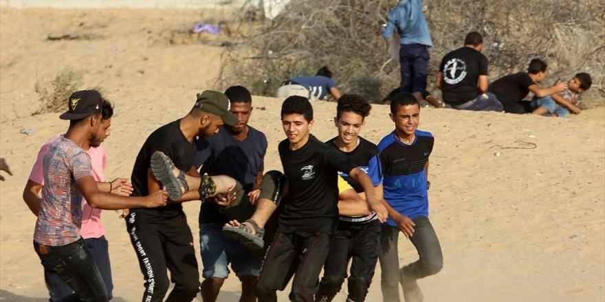 İsrail Askerleri Gazze Sınırında 74 Filistinliyi Yaraladı