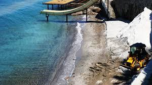 Bodrum'da sahile 'beyaz kum' diye mermer tozu dökmeye çalışan otele 345 bin lira ceza